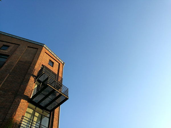 Balcony with glass bottom at a former storage building with blue sky in Münster in Westfalen Apartment Architecture Balcony Blue Blue Sky Brick Brown Building Building Exterior Dockside Dockside Storage Germany🇩🇪 Glass Bottom Hafenweg Kreativkai Low Angle View Münster Münsterland Nordrhein-Westfalen Red Brick Sky Storage Sunshine Westfalen Window
