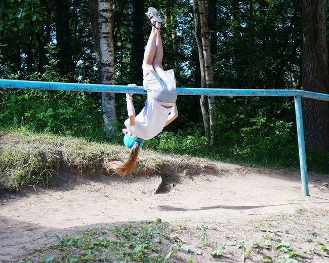 Full length of girl balancing on railing