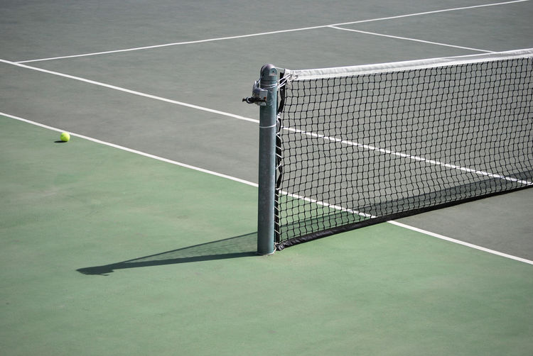 Arms Raised Ball Competition Court Day Dividing Line High Angle View Leisure Activity Lifestyles Men Net - Sports Equipment Outdoors People Playing Racket Racket Sport Real People Sport Tennis Tennis Ball Tennis Net Tennis Racket Yard Line - Sport
