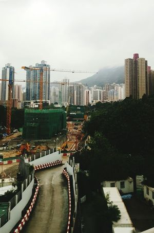 Construction sites in Hong Kong Architecture Built Structure Development Engineering Construction Machinery people and places