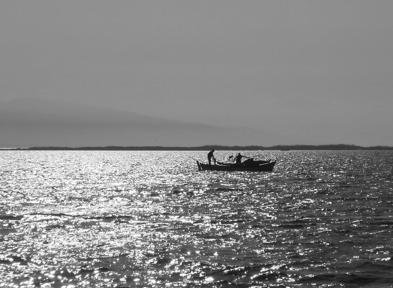 water, sea, transportation, nature, waterfront, nautical vessel, horizon over water, scenics, men, real people, silhouette, beauty in nature, mode of transport, clear sky, outdoors, sky, two people, sailing, day, people