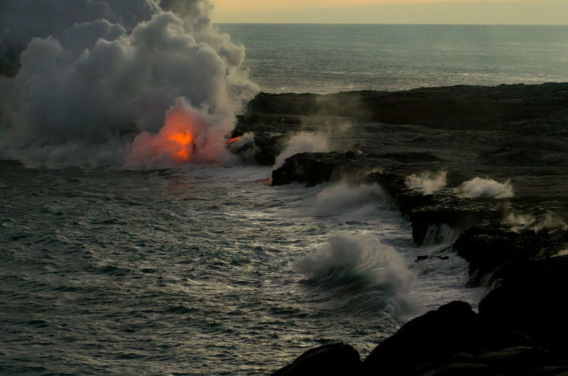 Beauty In Nature Big Island Day Erupting Geology Hawaii Heat - Temperature Lava Natural Disaster Nature No People Ocean Outdoors Power In Nature Sea Smoke - Physical Structure Volcanic Rock Water