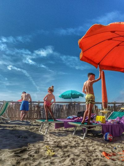EyeEmNewHere Sky Beach Leisure Activity Land Women Cloud - Sky Water Lifestyles Group Of People Holiday Umbrella People Sand Men Real People Outdoors Day Sea Toscana Italy Italiansummer Summer Beachphotography Sunandclouds
