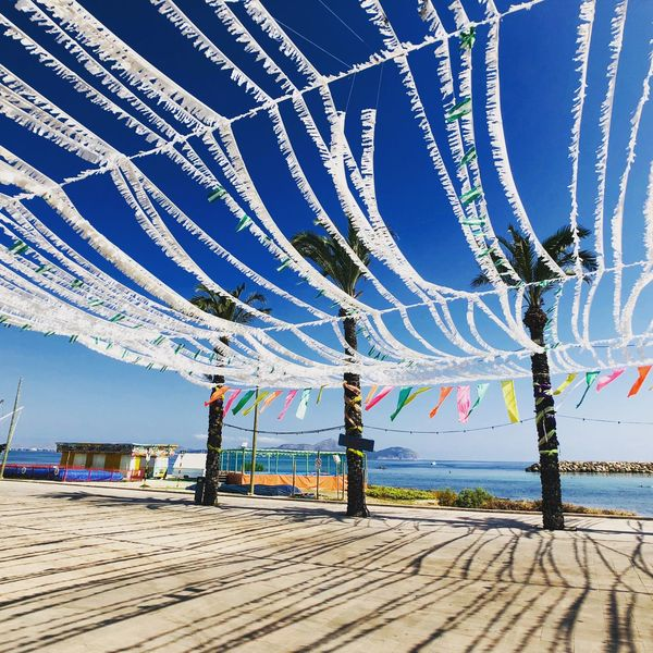 At the beach Summer Sky Day No People Nature Outdoors Water Land Decoration Sea Transportation In A Row Blue Beach Architecture Scenics - Nature Beauty In Nature Built Structure Sunlight