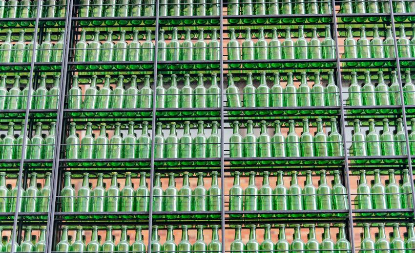 Full frame shot of wine bottles on rack