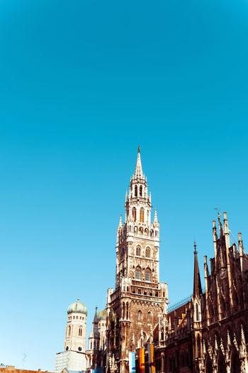 Architecture Astronomical Clock Blue Building Exterior Built Structure City Cityscape Clear Sky Clock Day History Marienplatz No People Outdoors Place Of Worship Rathaus Sky Travel Destinations Tree