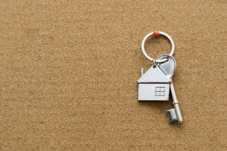 Close-up of house key on bulletin board