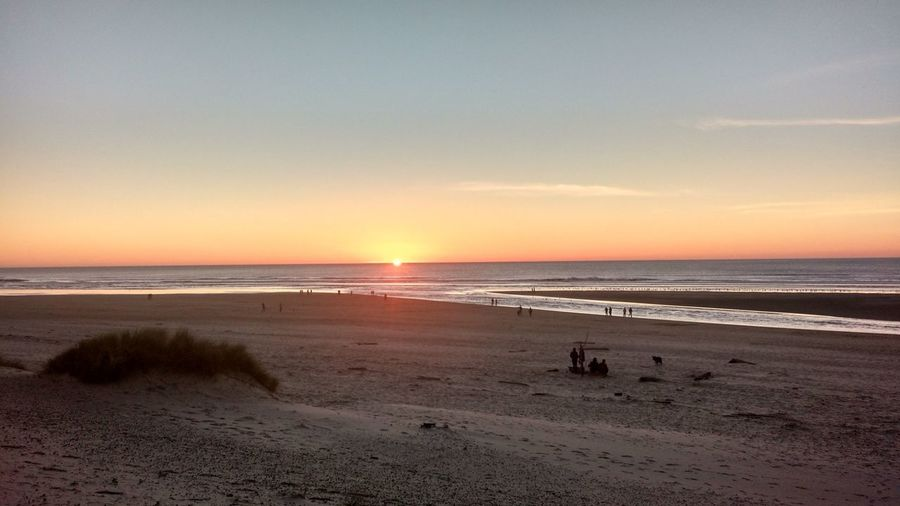 Sea Beach Sunset Horizon Over Water Sand Summer Nature Beauty In Nature Sky Outdoors Scenics Travel Destinations Landscape People Adult Day Romantic Sky Oregon Coast Canon Beach Tranquility Beauty In Nature