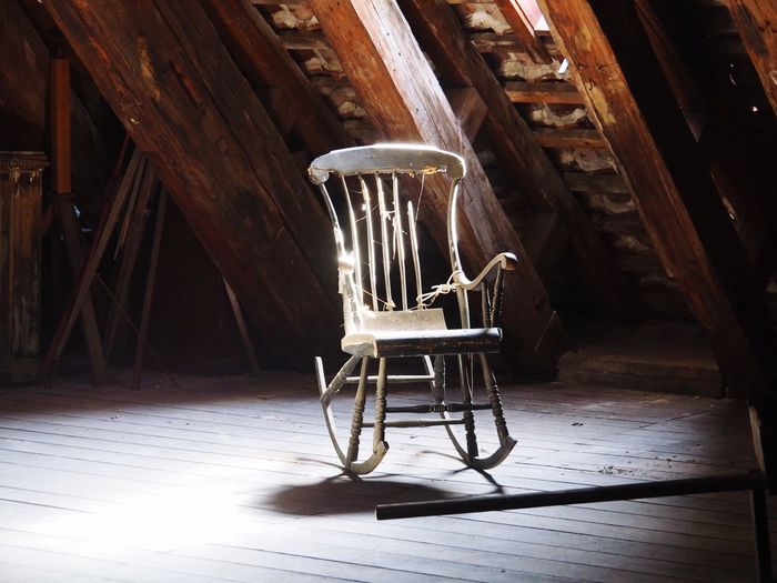 View of chair at abandoned house
