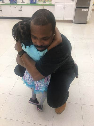 Real People Full Length Indoors  Two People Casual Clothing Childhood Day People Father And Daughter Father daddy Daughter Hugging Kneeling Down Parent parenting Preschool leaving Goodbye Fathers day. Little Girl Three Years Old