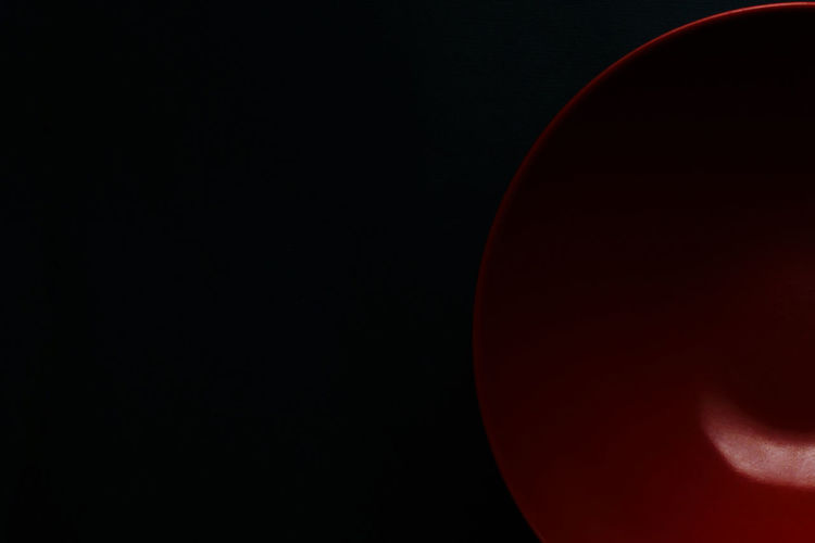 Close-up of red light over black background