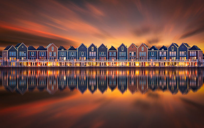Remo SCarfo Amsterdam Holland Hout Bay Dutch Sunset EyeEm Best Shots Water Architecture Sky Built Structure Reflection Cloud - Sky No People Nature Orange Color Sea Building Exterior Beauty In Nature Illuminated Scenics - Nature Waterfront Building Tranquility Outdoors