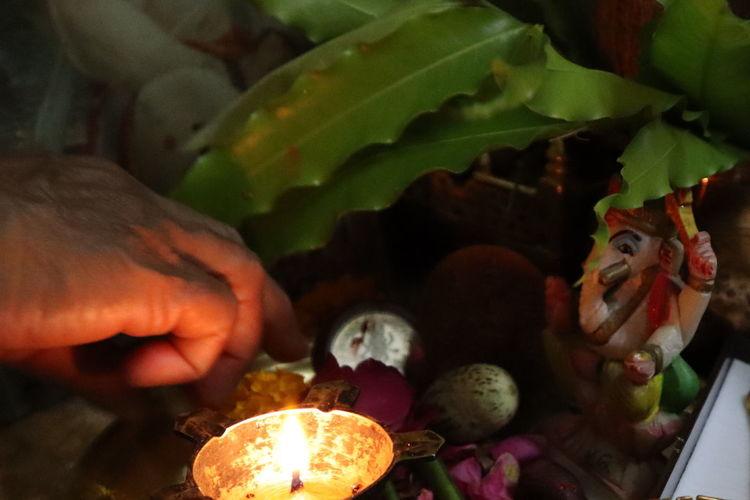 #God #praying #Ganeshji Human Hand Flame Close-up
