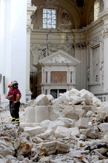 L'Aquila after the earthquake: church of Santa Maria di Collemaggio Church L'Aquila Architectural Column Architecture Building Building Interior Built Structure Church Buildings Earthquake Earthquake Area Earthquake In Italy Earthquake L'aquila Earthquake L'aquila Firefighters Firefighters In Action Indoors  Lifestyles Men One Person Place Of Worship Real People Rear View Rubble Spirituality Standing