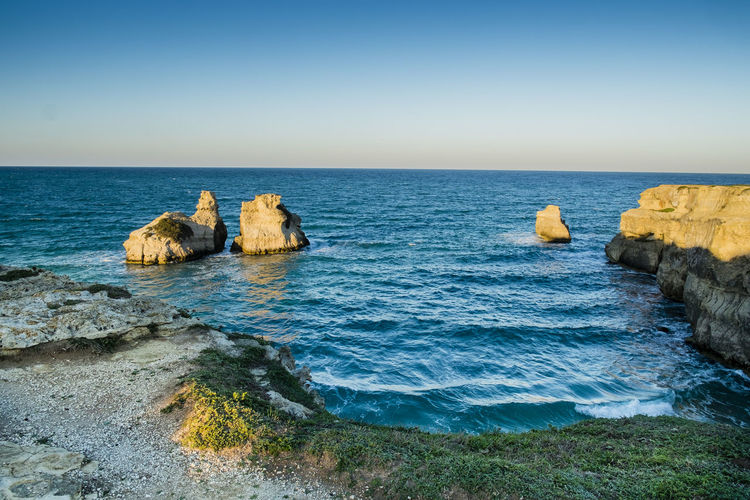 Two Sisters - Melendugno - Lecce - Italy Beach Beachphotography Beauty In Nature Blue Clear Sky Coast Day Horizon Over Water Italy Landscape Nature No People Outdoors Rock - Object Salento Scenics Sea Sky Sunset Tranquil Scene Travel Travel Destinations Travel Photography Water Waves, Ocean, Nature
