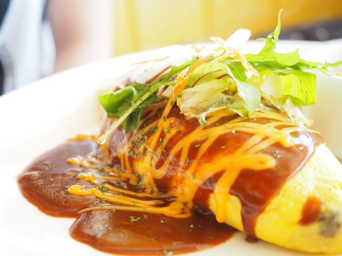 Enjoying A Meal Omelet With A Filling Of Ketchup‐seasoned Fried Rice Omurice Omelet Rice オムライス