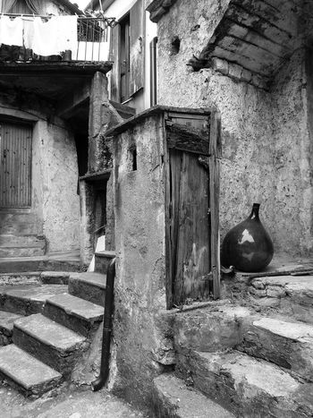 Glimpse with carboy Black & White Doors Italia Old Town South Italy Stairs Steps Architecture Black And White Black And White Photography Bottle Building Exterior Built Structure Calabria Carboy Glimpse No People Outdoors Travel Destination Verbicaro