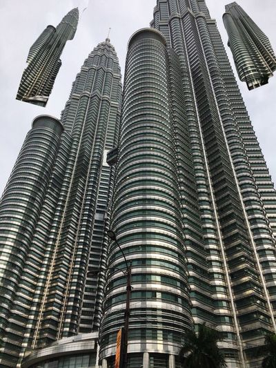Cut And Paste Architecture Building Exterior Skyscraper Built Structure Tall - High IPhoneography Architecturephotography Lovetotravel Petronas Twin Towers Malaysia EyeEmNewHere Vacations Low Angle View City Tower Day Outdoors No People Travel Destinations Sky Tall Urban Skyline Cityscape