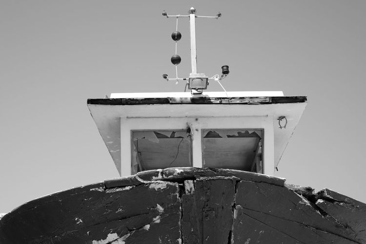 Low angle view of trawler against clear sky