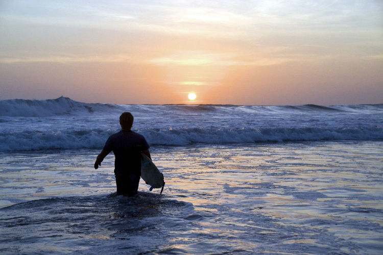 The moment you dive into the ocean to surf. Flow  Nicaragua Relaxing Sunset_collection Surf Beach Beauty In Nature Extreme Sports Fun Leisure Activity Nature Ocean One Person Sea Silhouette Sky Sundown Sunset Surfing Vacations Water Waterfront Wave Waves Weekend Activities