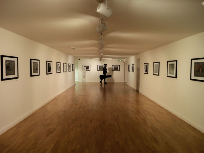 Guitar Corridor - MartinGuitar Art Artist Musician Artgallery Whitewalls  Corridor Young Adult Indoors  Gallery Shadows & Lights TakeoverMusic