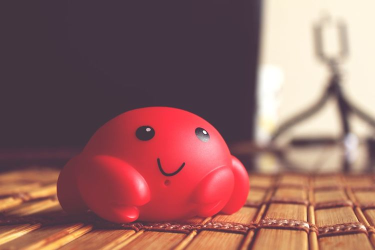 Close-up of red toy on table