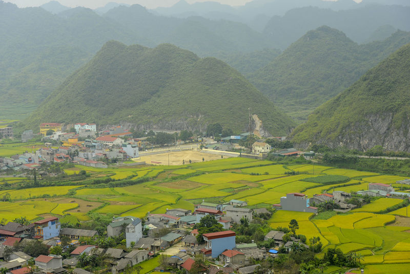 Beautiful View of Quan Ba town in Ha Giang district during cloudy and foggy morning. Witness of the twin mountain . The road is the gateway to the Dong Van Karst Plateau Geopark Quản Bạ World Heritage Site By UNESCO Unesco Landscape Geopark Town Paddy Fields