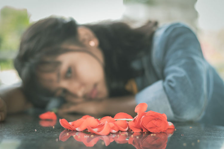 Concept of love break up, or failure, selective focus on red roses.
