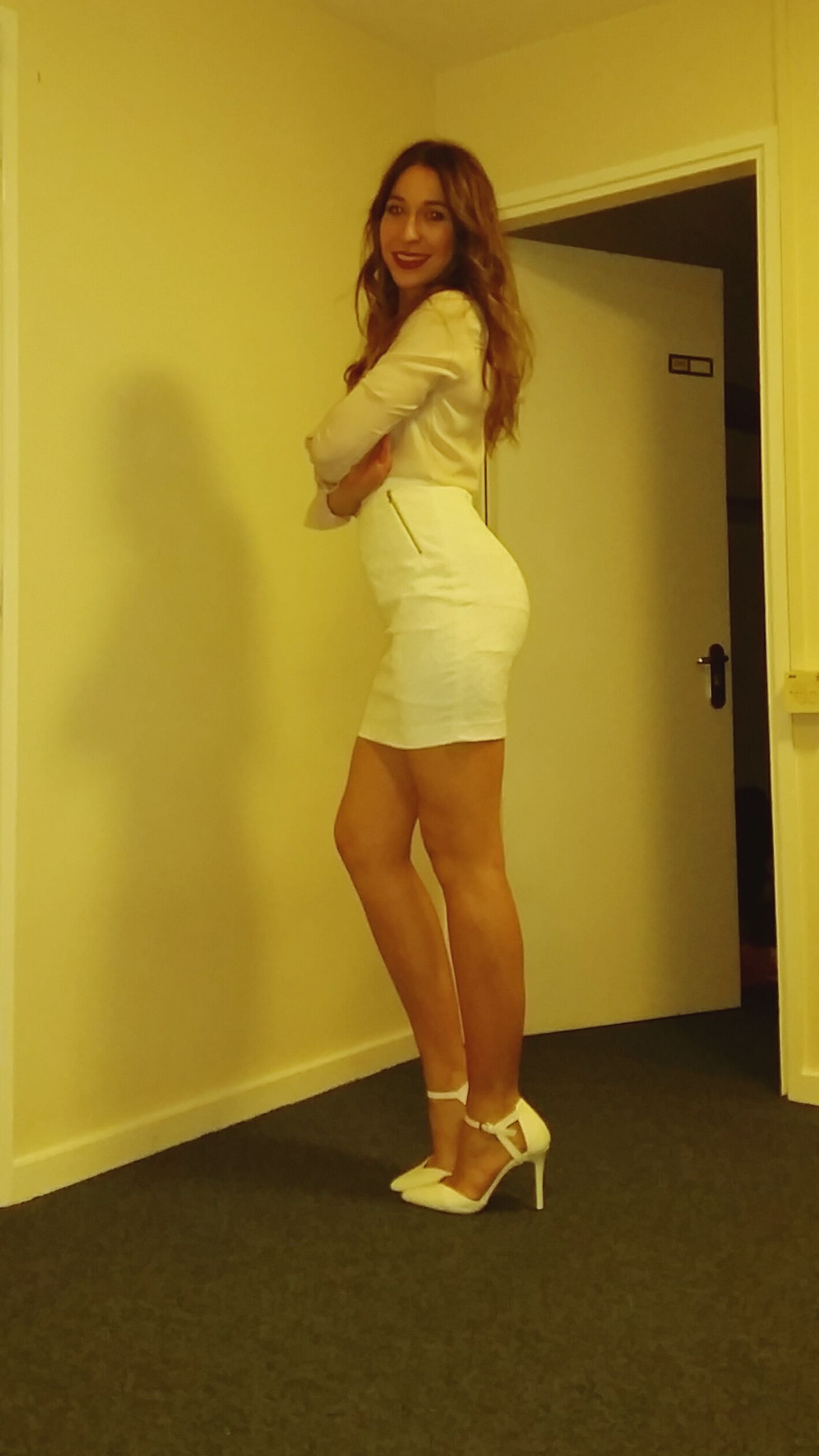 young adult, person, indoors, young women, full length, casual clothing, looking at camera, front view, portrait, lifestyles, leisure activity, standing, three quarter length, wall - building feature, smiling, dress, long hair