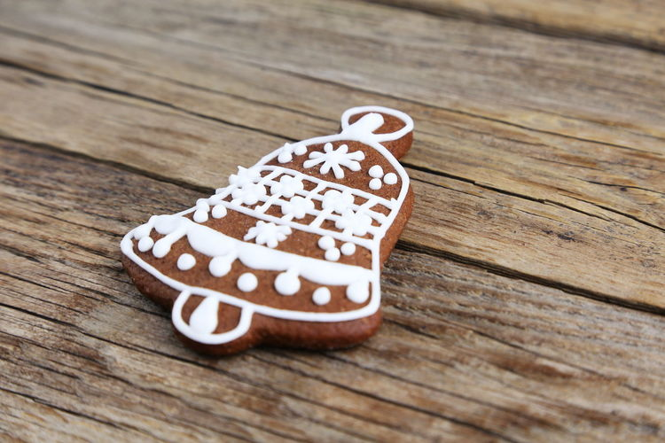 Gingerbread Cookie Sweet Food Christmas Decoration Shape Bell Wood - Material Table Still Life Indoors  No People Close-up Food And Drink High Angle View Selective Focus Baked Brown Sweet Food Freshness Indulgence Creativity Art And Craft Snack
