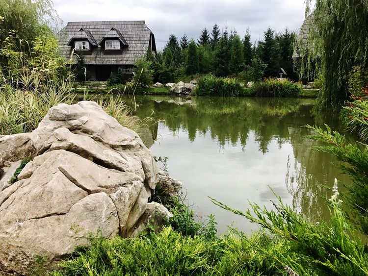 Iphone photography Water Tree Nature Reflection Outdoors Lake Day No People Built Structure Architecture Beauty In Nature Tranquility Tranquil Scene Scenics Growth Plant Building Exterior Grass Sky Nature Watermill Architecture Beauty In Nature Travel Destinations Tranquility Perspectives On Nature