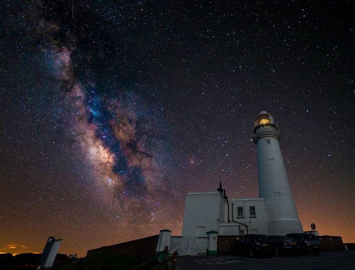 Architecture Astronomy Beauty In Nature Building Building Exterior Built Structure Galaxy Lighthouse Low Angle View Milky Way Nature Night No People Outdoors Scenics - Nature Sky Space Space And Astronomy Star Star - Space Star Field Tower