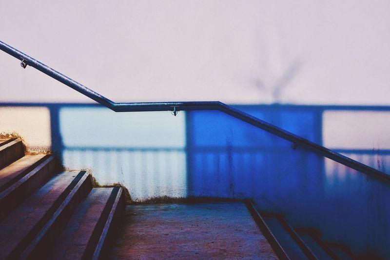 Railing against sky