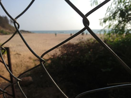 Chainlink Fence Metal Security Protection Safety Barbed Wire No People Day Outdoors Nature Close-up Sky Mobiography Mobile Phone Photography Xperıa Sony Xperia XperiaZ5 India Bhatkal Beachlife Beach