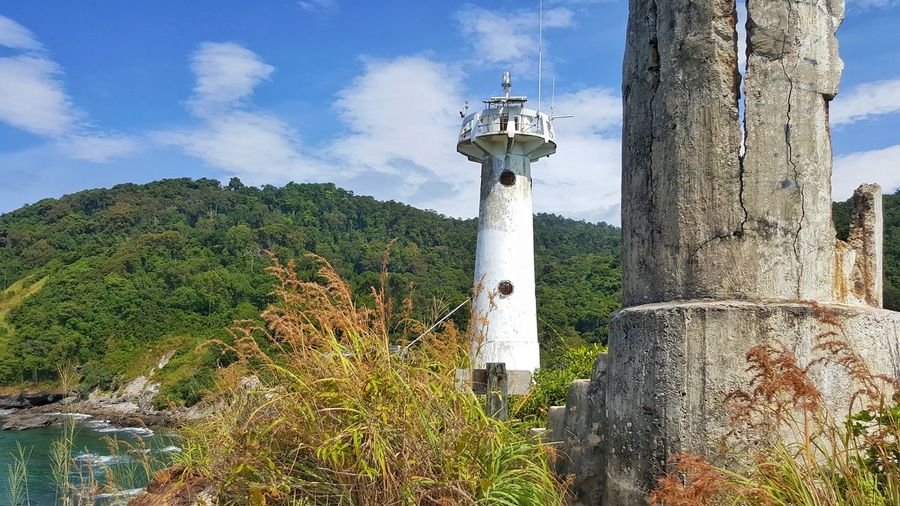 Lighthouse tower in beautiful nature. Vacations Travel Destinations Koh Lanta Tropical Climate Tropical Paradise National Park Lighthouse Tower Krabi Thailand Encient Cloud - Sky Sky Outdoors No People Day Statue Nature Water Tree Close-up