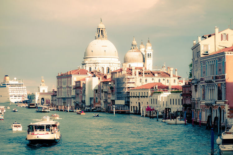 Santa Maria Della Salute By Canal Against Sky