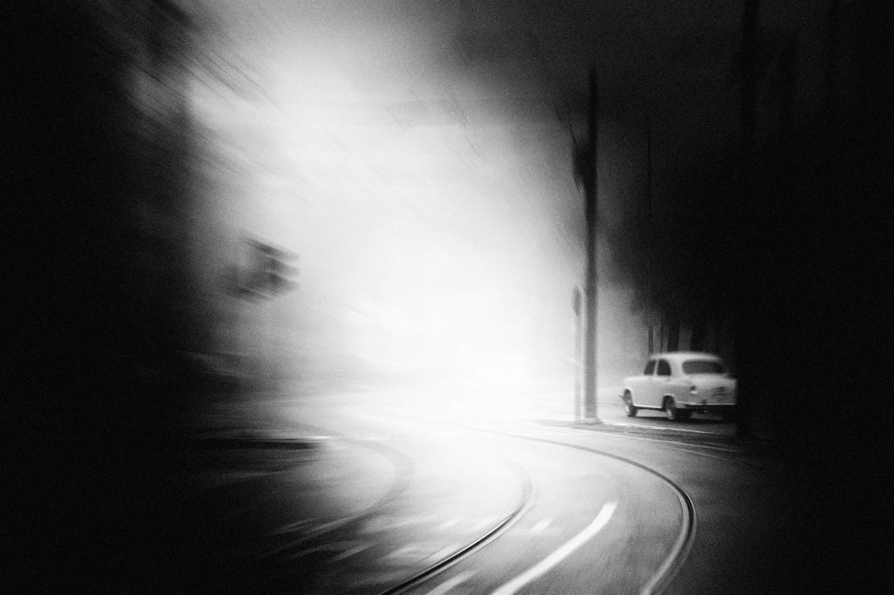transportation, mode of transportation, motion, blurred motion, road, land vehicle, no people, on the move, architecture, motor vehicle, car, speed, city, day, street, built structure, direction, outdoors, the way forward, marking, road trip