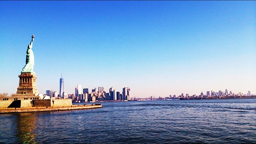 New York Ellis Island  The Architect - 2016 EyeEm Awards New York Skyline  Statue Of Liberty Skyline Empire State Building Blue Wave Tradition Meets Modern Calm Sea On The Way