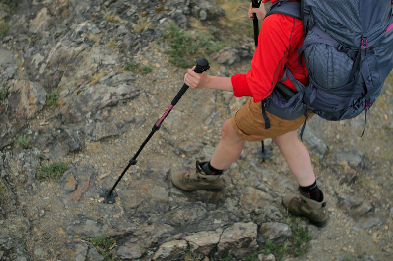 female hiker walking on a trail Alpine Backpacking Camping Expedition Freedom Hiking Nature Travel Trekking Woman Active Activity Adventure Backpack Boot Challenge Climbing Day Detail Determination Effort Extreme Sports Female Full Length Hiking Hobbies Legs Leisure Activity Low Section Men Nature Outdoors People person Rock Rock - Object Rock Climbing Solid Sport Trek Walking
