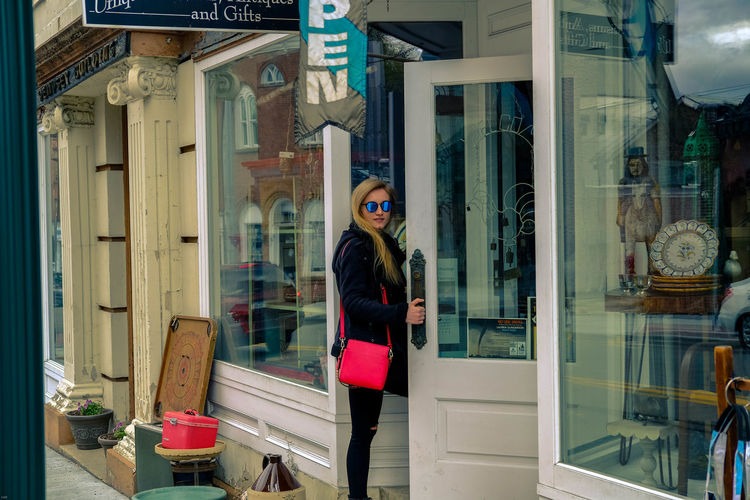 Vintage Shopping The Fashion Photographer - 2018 EyeEm Awards Standing Full Length Store Looking Through Window Window Reflection Store Window Sunglasses Building Exterior Window Shopping Window Display Shopping Bag Entryway Entrance Entry