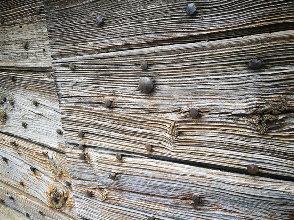 wood from an old churchdoor in France Barnwood Oldwood Vintage Concentric Astronomy Backgrounds Full Frame Textured  Wood Grain Pattern Wood - Material Abstract Close-up Knotted Wood Weathered Worn Out Hardwood Nail Cracked