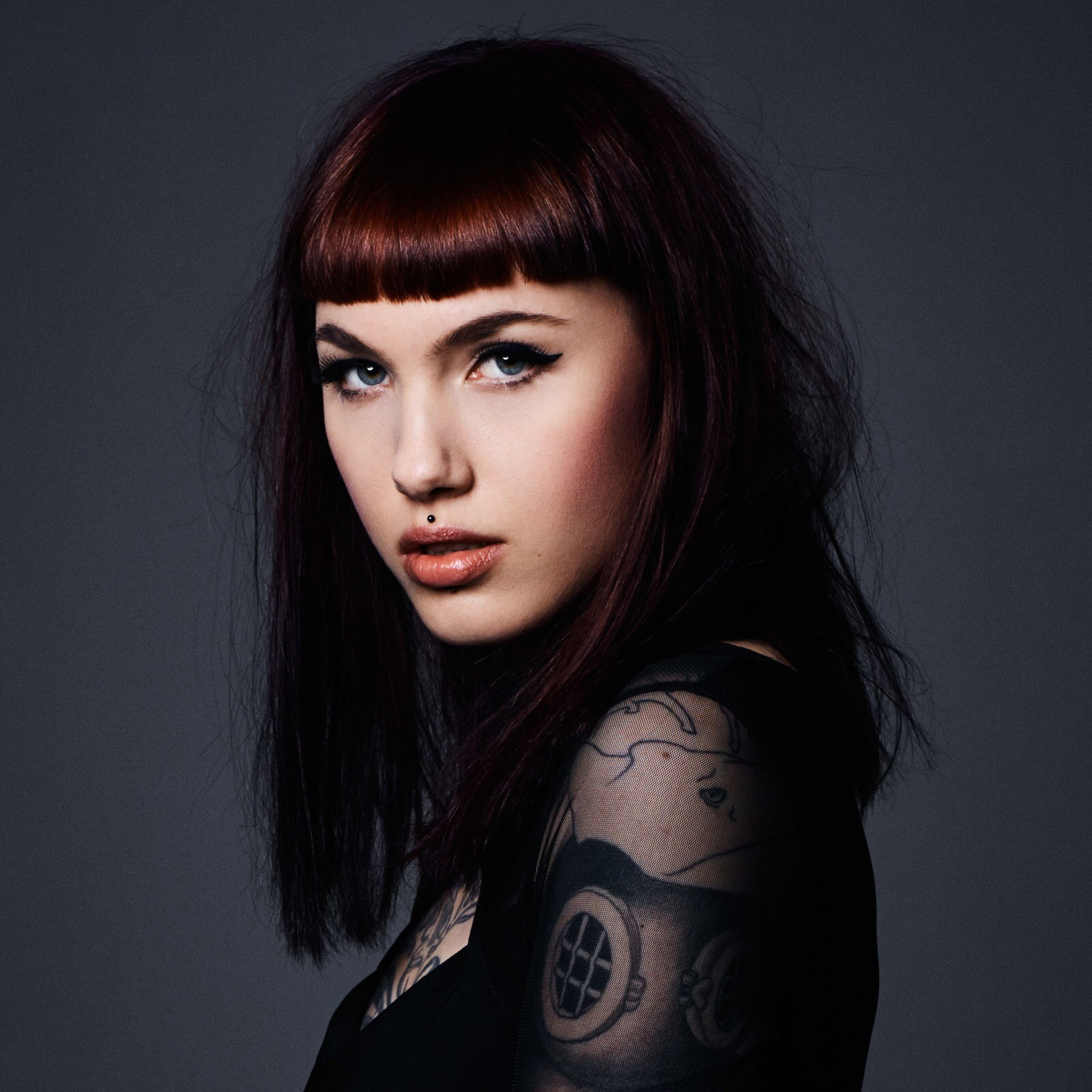 tattoo, looking at camera, studio shot, portrait, young adult, fashion, beautiful woman, long hair, one person, young women, real people, headshot, gray background, medium-length hair, beauty, dyed hair, one young woman only, close-up, indoors, day, adult, people