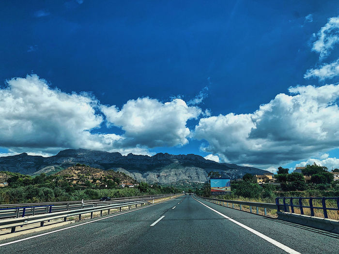 Scenic view of highway against sky