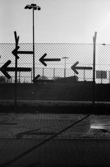 Black And White Monochrome Contrast Filmisnotdead Analog Notes From Berlin Film Is Not Dead Ishootfilm Film Photography Analogue Photography Film Arrows Leica_camera Walking Around The City  Fences Structures Light And Shadow Melancholy Berlin