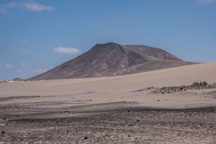 Fuerteventura Arid Climate Beauty In Nature Clear Sky Day Desert Extreme Terrain Geology Kanarische Inseln Landscape Mountain Nature No People Non-urban Scene Outdoors Physical Geography Remote Sand Sand Dune Scenics Sky Tranquil Scene Tranquility Travel Destinations Volcanic Landscape