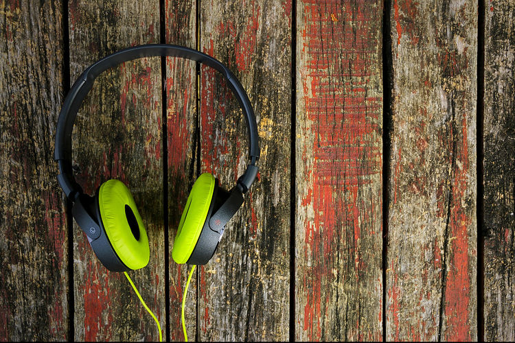 Green headphone on old wooden table. Audio Desk Earphones Listening To Music Music Relaxation' Sound Wood Accessory Cable Color Device Ear Electricity  Gadget Headphone Headset Idea Moblie Object Pair Stereo Vintage Volume