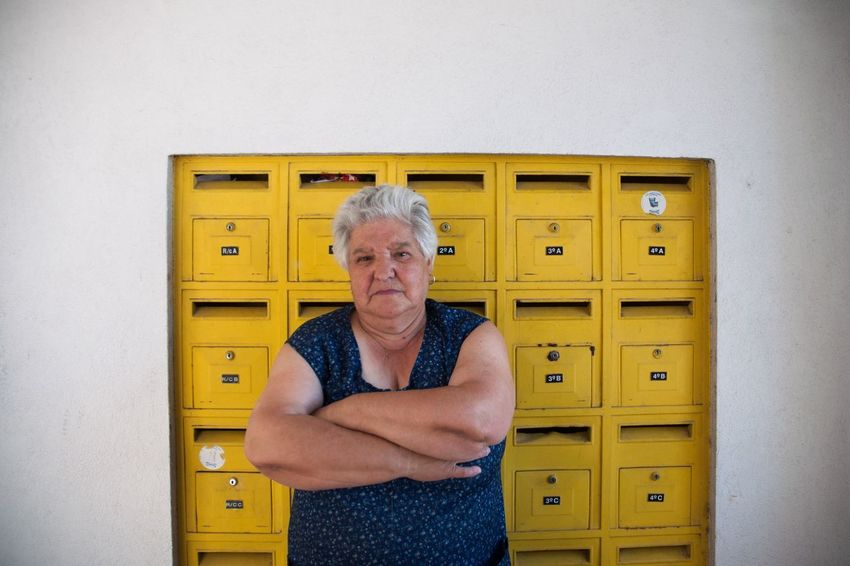 The Portraitist - 2017 EyeEm Awards Portugal Marvila Yellow Waist Up Senior Adult Looking At Camera One Person Portrait Front View Wood - Material Indoors  Locker Room Architecture Smiling Only Women One Woman Only Day People Human Hand Close-up Adult Adults Only