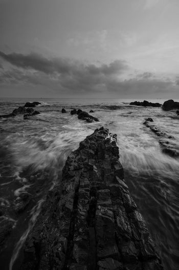 Amazing rock formations at Pandak beach, Terengganu in black and white monochrome fine art technique.  Nature composition blur soft focus noise visible due to long exposure effect. Fine Art Black And White Amazing View Amazing Black&white Fine Art Photography Black Terengganu Malaysia Wallpaper EyeEm Nature Lover EyeEm Backgrounds Blackandwhite Wave Sea Water Beach Sunset Low Tide Sky Horizon Over Water Landscape Cloud - Sky Seascape Rock Formation