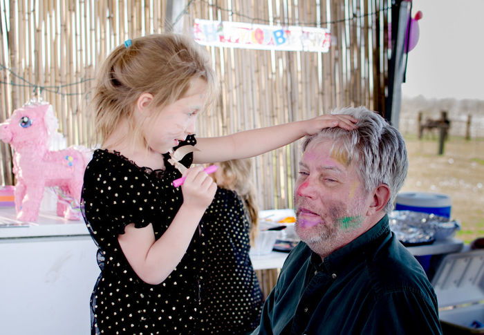 a young girl looks over her artistic handiwork, as her grandfather sits back and is a good sport under all the crazy make up Artistic Face Painting Family Makeup Adult Blond Hair Creative Day Good Sport Grandpa Indoors  Kid Photography Little Girl People Senior Man Smiling Tolerant Two People Young Women This Is Masculinity This Is Aging Visual Creativity The Photojournalist - 2018 EyeEm Awards Creative Space