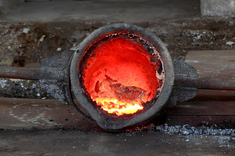 Hot steel pouring at steel plant Burning Coal Fire Fire - Natural Phenomenon Flame Foundry Glowing Heat - Temperature Indoors  Industry Iron - Metal Kitchen Utensil Making Man Made Object Melting Metal Metal Industry Nature No People Preparation  Red Workshop